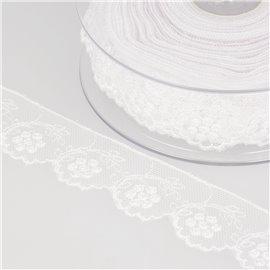Tulle brodé fleurs 32mm blanc au mètre